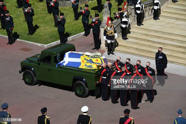 Pallbearers of the Royal Marines stand by the coffin as it arrives at the West Steps of St George's Chapel during the ceremonial funeral procession...