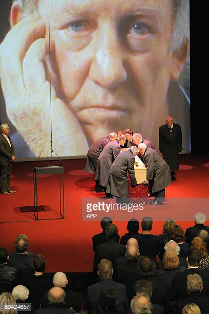 Pallbearers place the coffin of Belgian writer Hugo Claus on the stage of the Bourla theater in Antwerp during his funeral on March 29 2008 Claus...