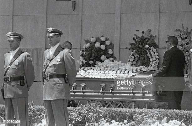 Pallbearers put casket into place on stand in front of the Mausoleum Between guards at left on curtain covered crypt that will be the final resting...