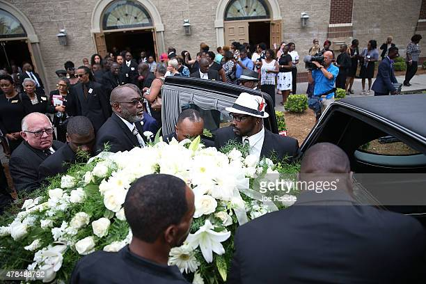 Pallbearers put the casket of Ethel Lance who was one of nine victims of a mass shooting at the Emanuel African Methodist Episcopal Church into the...
