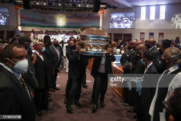 Pallbearers recess out of the church with the casket following the funeral for George Floyd at The Fountain of Praise church on June 9 2020 in...