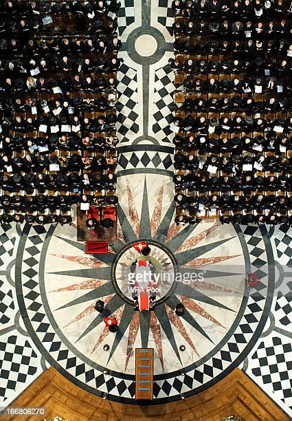 Pallbearers set down the coffin of Baroness Thatcher inside St Paul's Cathedral on April 17 2013 in London England Dignitaries from around the world...