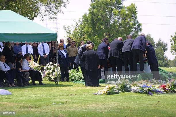 Pallbearers set down the coffin of Matthew Ansara the son of actress Barbara Eden July 2 2001 at Ansara''s funeral in Hollywood CA Matthew Michael...