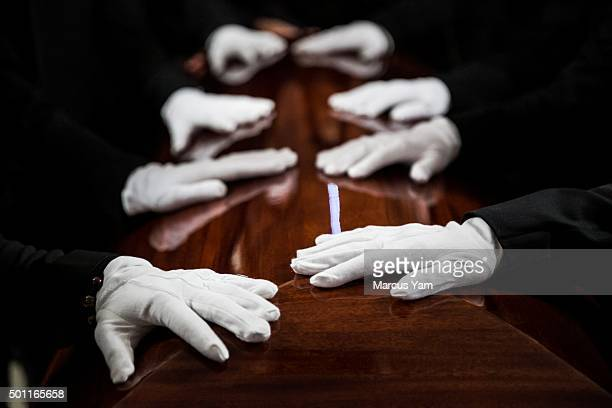 Pallbearers stand guard over the casket of the slain Tin Nguyen one of the victims of the deadly San Bernardino terrorist attack at the start of the...