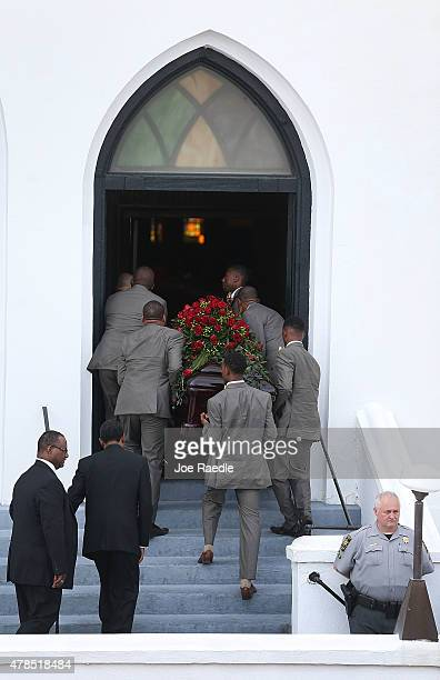 Pallbearers take the casket of church pastor and South Carolina State Sen Clementa Pinckney into the Emanuel African Methodist Episcopal Church where...