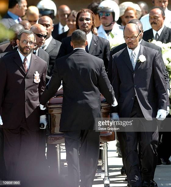 Pallbearers take the casket of the late Johnnie Cochran out of the West Angeles Cathedral in Los Angeles California April 6 2005