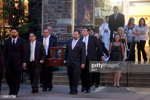 Pallbearers walk out of the funeral service for Lauren Giddings at St Mary of the Mills Catholic Church in Laurel Maryland Saturday August 6 2011...