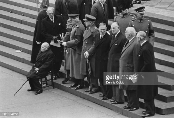 Pallbearers watch the coffin leave St Paul's Cathedral after the funeral service of former British Prime Minister Winston Churchill London 30th...