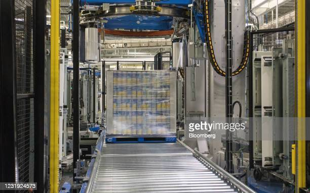Pallet of Clorox Disinfecting Wipes canisters moves along a conveyor belt at the company's manufacturing facility in Forest Park, Georgia, U.S., on...