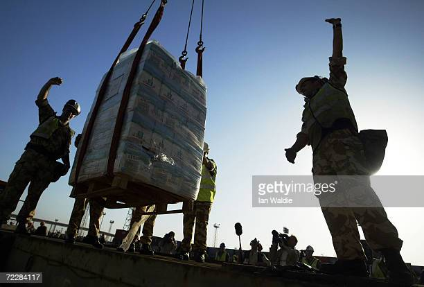 A pallet of fresh bottled water is lowered onto the dock from the British relief ship HMS Sir Galahad March 28 2003 in Umm Qasr Iraq The British...