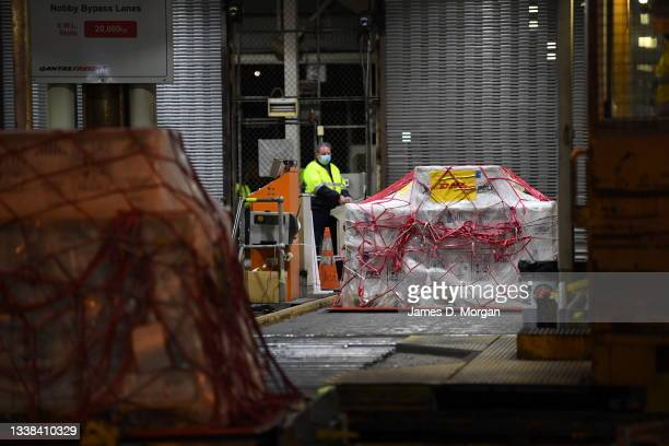 Pallet of Pfizer vaccines is unloaded at the Qantas freight terminal after landing on Qantas flight QF10 from London at Kingsford Smith International...