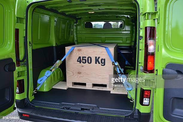 pallet with box in the cargo hold of a van - strap stock pictures, royalty-free photos & images