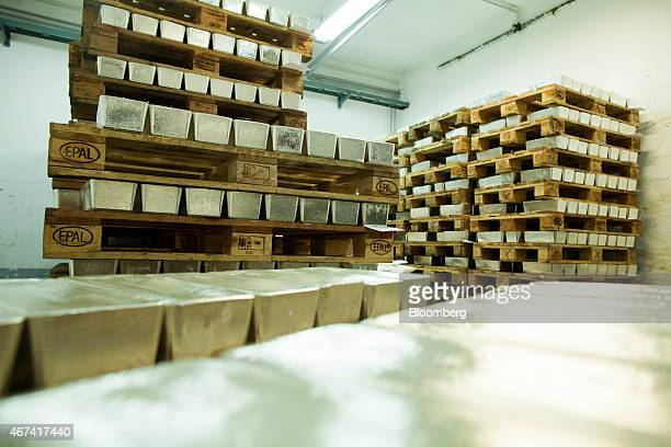 Pallets loaded with newly cast silver bullion bars sit in a saferoom ahead of export at the KHGM Polska Miedz SA smelting plant in Glogow Poland on...