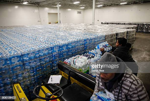 Pallets of bottled water are seen ready for distribution in a warehouse January 21 2016 in Flint Michigan The warehouse is the emergency water supply...