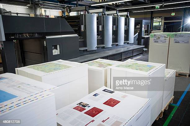 pallets of finished printed products in paper printing warehouse - printout stock pictures, royalty-free photos & images