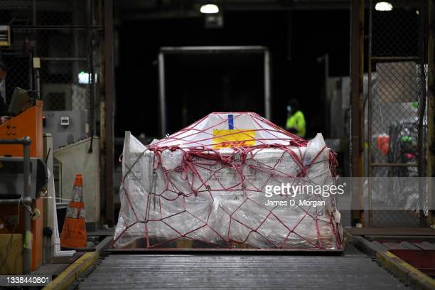 Pallets of vaccines being unloaded off Qantas flight QF110 from Darwin after landing at Kingsford Smith International Airport on September 05, 2021...