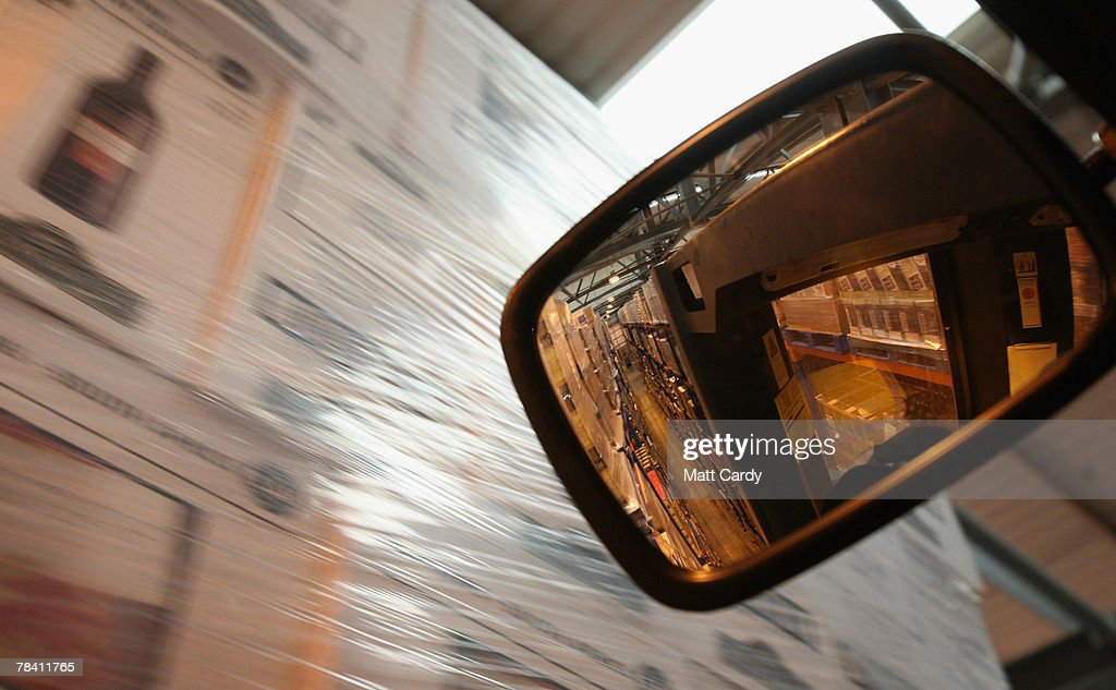 Pallets of wine are seen reflected in the mirror of a fork lift crane at the giant distribution centre in Avonmouth on December 12 2007 near Bristol, England. The giant warehouse, owned by Constellation Europe, is currently packed full of pallets of alcohol to be dispatched - with 90per cent destined for the UK - and means a lorry leaving every seven minutes, 24 hours a day, to keep up with demand.