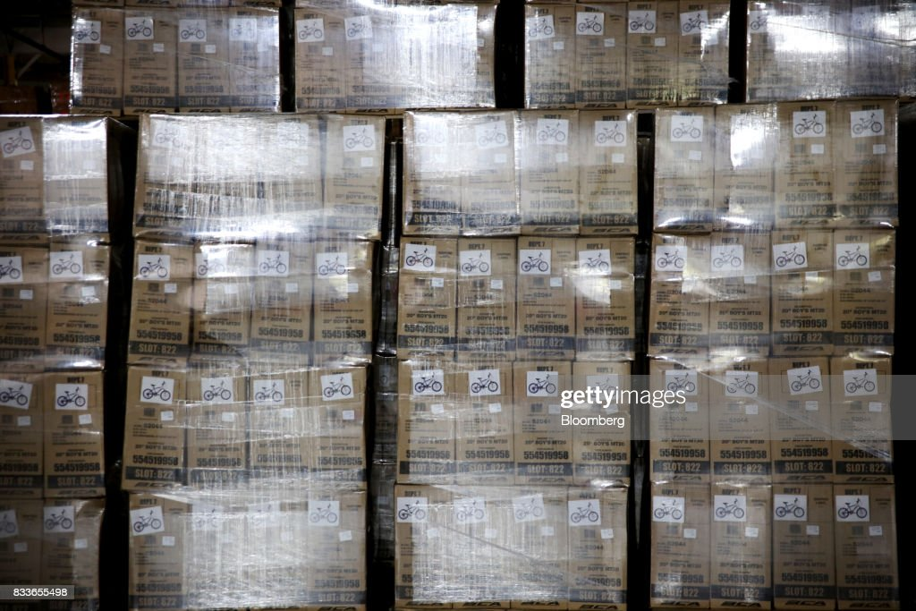 Pallets with boxes of bicycles sit at The Kent International Inc. Bicycle Corporation of America brand Assembly facility in Manning, South Carolina, U.S., on Sunday, June 25, 2017. Almost all of the roughly 18 million bicycles sold each year in the U.S. come from China and Taiwan. This year, about 130 workers at the Bicycle Corporation of America's new factory will assemble 350,000 bikes in the U.S. Photographer: Travis Dove/Bloomberg via Getty Images