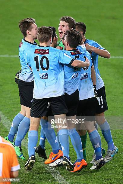 Palm Beach celebrate after winning in a penalty shoot out during the FFA Cup match between Palm Beach and South Melbourne at Cbus Super Stadium on...