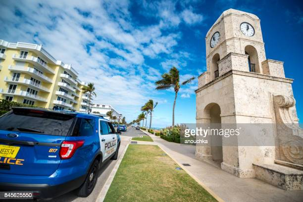 Palm Beach Clock Tower and police car parked, Florida, USA
