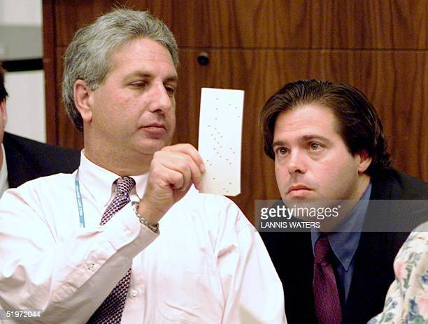 Palm Beach County canvassing board chair person Judge Charles Burton shows Republican attorney Marc Wallace a questionable ballot at the Emergency...