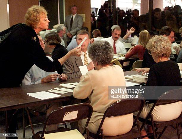 Palm Beach County Commissioner and member of the Board of Canvassers Carol Roberts looks at a ballot during the hand recount of the US presidential...