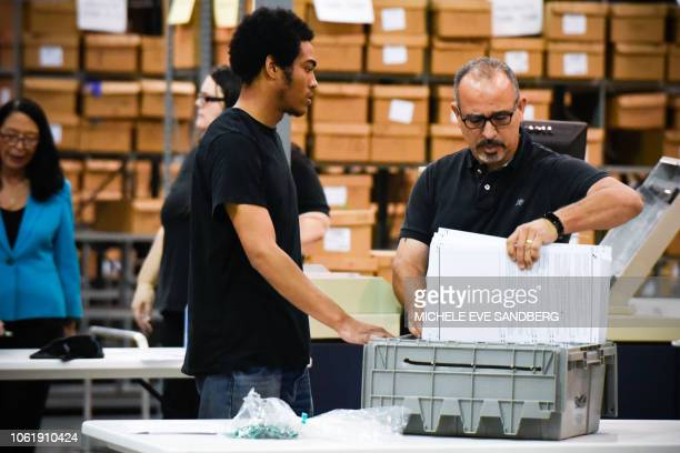 Palm Beach County election officials prepare to recount ballots on November 15 in West Palm Beach Florida Final results have yet to be declared in...