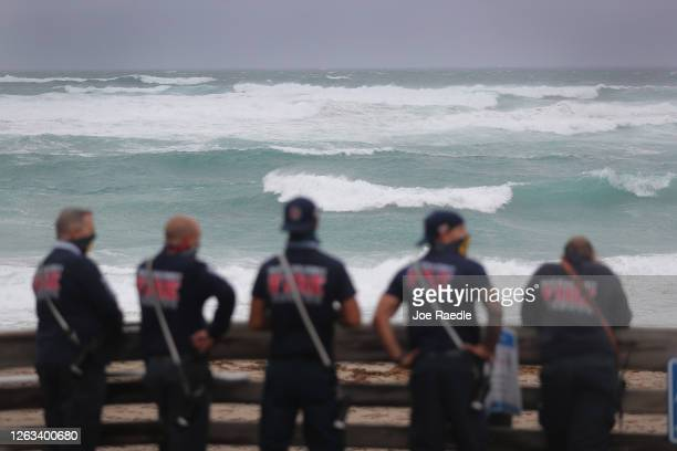 Palm Beach County Fire Rescue check out the ocean as waves crash ashore from Tropical Storm Isaias as it passes through the area on August 02, 2020...