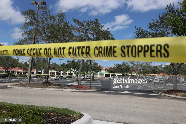 Palm Beach County Sheriff's crime scene tape is seen outside of a Publix supermarket where a woman, child and a man were found shot to death on June...