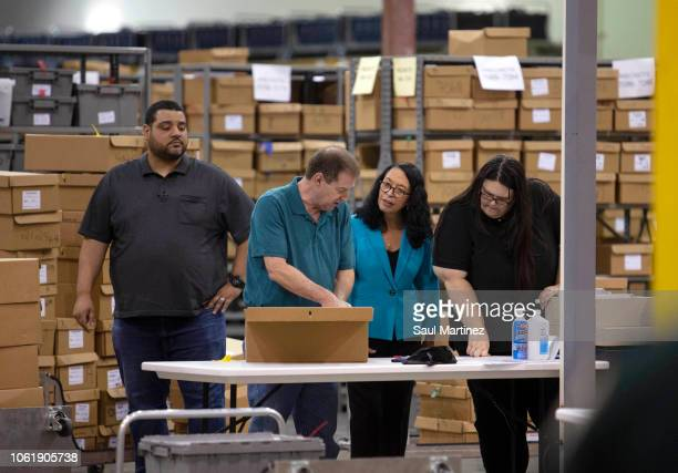 Palm Beach County Supervisor of Elections Susan Bucher supervises workers that are preparing to feed ballots through machines at the Supervisor of...