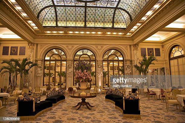 Palm Court, Neo-classical style with skylight, walls of Caen stone, marble pilasters and marble columns, at the Plaza Hotel, New York, NY