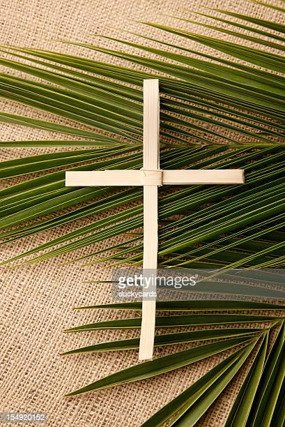 palm cross and branches on burlap - palm sunday stock pictures, royalty-free photos & images
