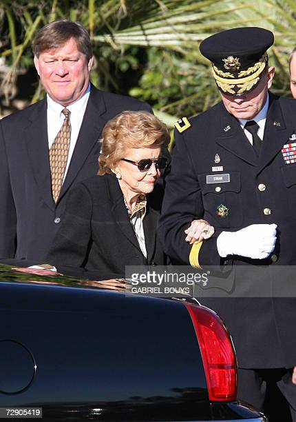 Betty Ford widow of Gerald Ford is helped by by Major General Guy C Swan III Commanding General Joint Task Force National Capital Region followed by...