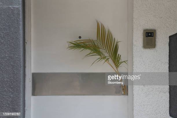 Palm leaves hang from a door during Palm Sunday in Caracas Venezuela on Sunday April 5 2020 Amid the coronavirus as the world's major religions enter...