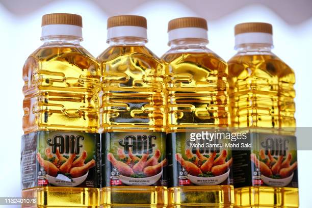 Palm Oil bottles are displayed during launch Love My Palm Oil campaign on March 24, 2019 in Carey Island outside Kuala Lumpur, Malaysia. The one-year...