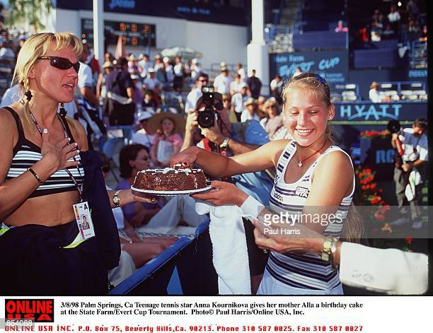 Palm Springs Ca Teenage tennis star Anna Kournikova givers her mother Alla a birthday cake at the State Farm/Evert Cup Tournament