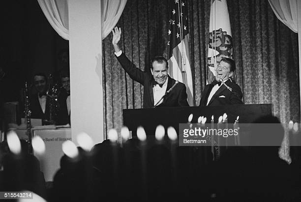 Palm Springs, Calif.: At the candlelighted State Dinner of the Republican Governor's Conference, Gov. Ronald Reagan of California breaks up as...