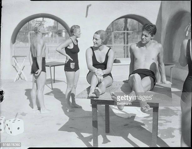 Olympic Stars Perform Frank Kurtz Eleanor Holm Georgia Coleman and Mickey Riley rest a bit after diving and swimming exhibitions by Olympic stars at...