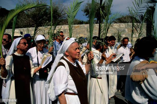 palm sunday procession on mount of olives - palm sunday stock pictures, royalty-free photos & images