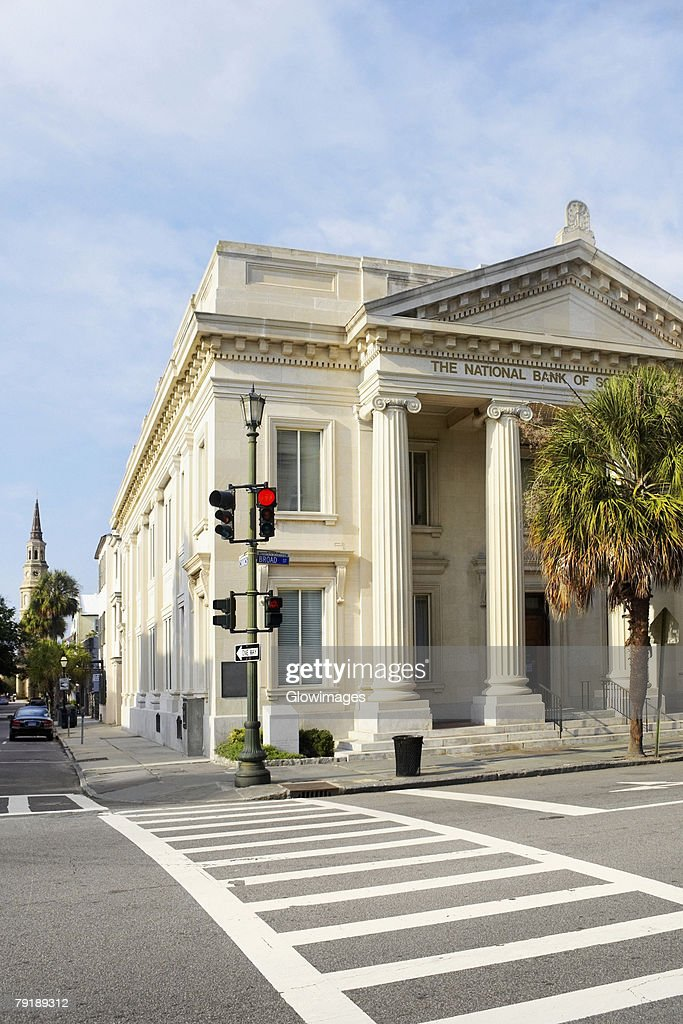 Palm tree in front of a bank, National Bank of South Carolina, Charleston, South Carolina, USA : Stock Photo