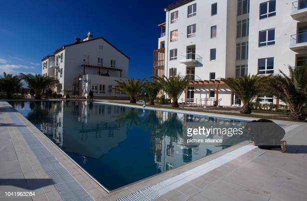Palm trees and a swimming pool are seen in the Olympic Village next to the Olympic Park in Sochi, Russia, 19 December 2013. The accommodations for...