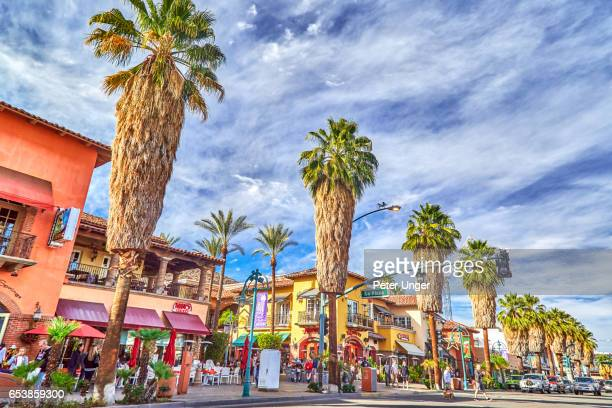 palm trees and main street of palm springs,california,usa - palm springs stock-fotos und bilder
