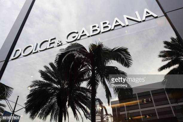 Palm trees are reflected in a window of the Dolce Gabbana Srl store on Rodeo Drive in Beverly Hills California US on Saturday Dec 9 2017 The US...