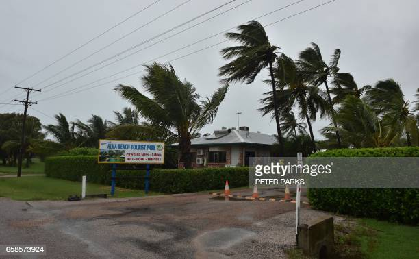 TOPSHOT Palm trees blow in the wind in the town of Ayr in far north Queensland as Cyclone Debbie approaches on March 28 2017 Lashing rain and howling...
