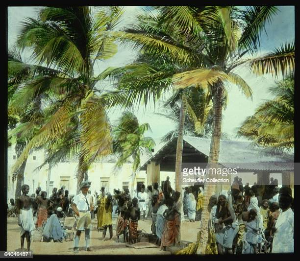 Palm trees blow in the wind over the market of Brava Somaliland 1920s | Location Brava Italian Somaliland