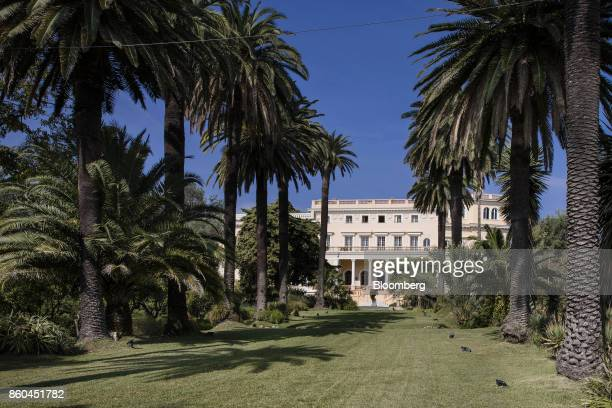 Palm trees line the lawn avenue in the private gardens leading to the Villa Les Cedres a 187yearold000squarefoot 14bedroom mansion set on 35 acres in...
