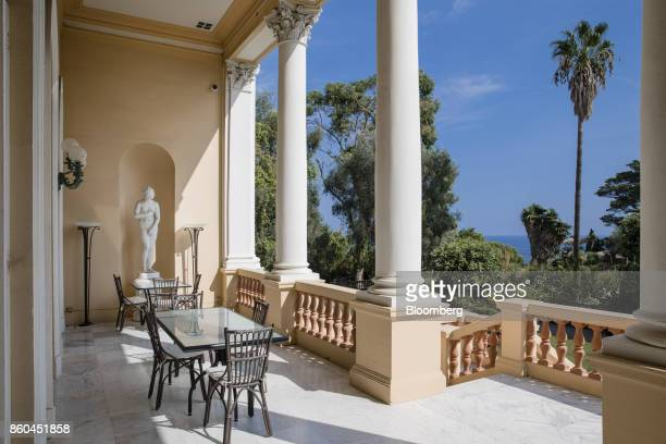 Palm trees stand beyond columns on a terrace at the Villa Les Cedres a 187yearold000squarefoot 14bedroom mansion set on 35 acres in...