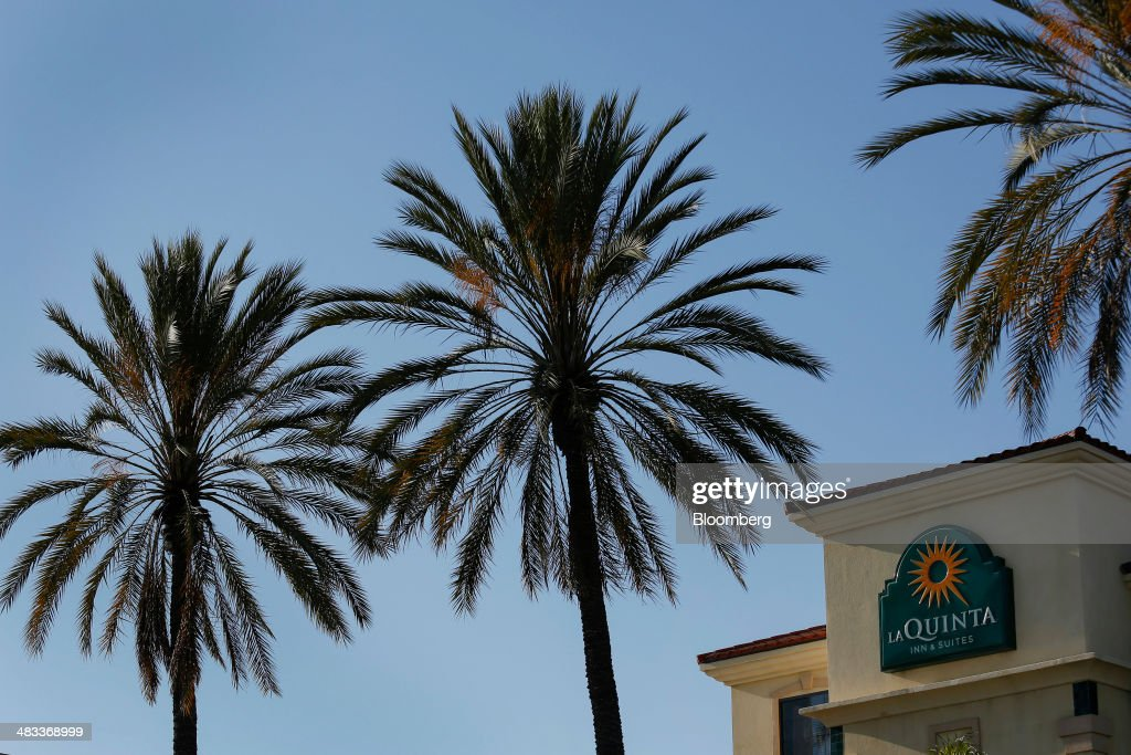 Palm Trees Stand In Front Of A La Quinta Holdings Inc Hotel Location In Hawaiian  Gardens