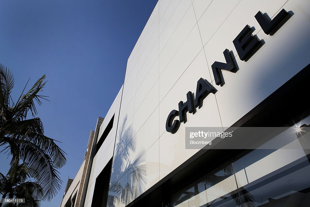 Palm trees stand next to a Chanel store on Rodeo Drive in Beverly Hills, California, U.S., on Wednesday, Sept. 11, 2013. The U.S. Census Bureau is scheduled to release retail sales figures on Sept. 13. Photographer: Patrick T. Fallon/Bloomberg via Getty Images
