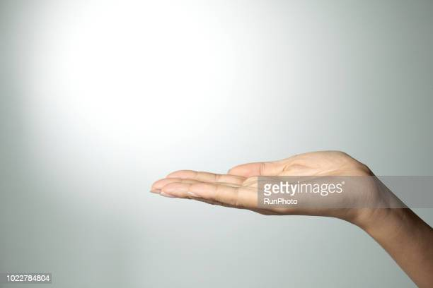 palm up hand - giving stock photos and pictures
